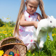 Child petting the Easter bunny - Stock Photo