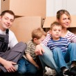 Family moving in their new - Stock Photo