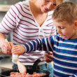 Family cooking in their kitchen — Stock Photo #5024500