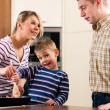 Family cooking in their kitchen - Stock Photo