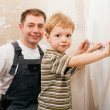 Father and son measuring a dry - Stock Photo