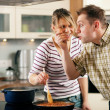 Stock Photo: Family cooking in their kitchen