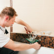 Plumber installing a mixer tap in — Stock Photo