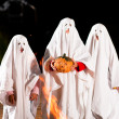 Three very, very scary spooks - Stock Photo