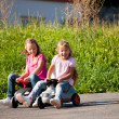Two sisters with toy cars — Stock Photo