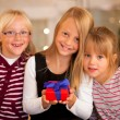 Three Girls in front of a — Stock Photo #5024645