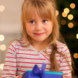 Stock Photo: Girl in front of a Christmas tree