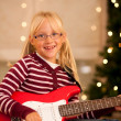 Young child with her guitar — Stock Photo