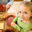 Stock Photo: Little girl eating breakfast or