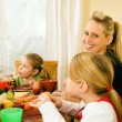Family having dinner or lunch — Stock Photo