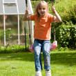 Little girl child sitting on a swing — Stock Photo #5024839