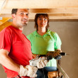 DIY couple in home - Stock Photo