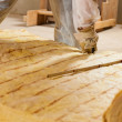 Man cutting insulation material for building — Stock Photo