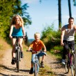 Family with child on their bikes - Stock Photo
