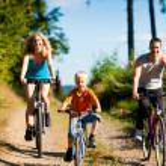 Family with child on their bikes — Stock Photo