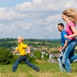Young family having a walk in — Stock Photo