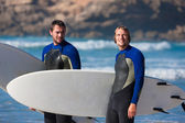 Two surfers with their surf — Stock Photo