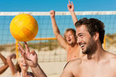 Man playing beach volleyball — Stock Photo
