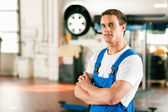 Auto mechanic standing in his — Stock Photo