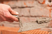 Bricklayer laying bricks to make — Stock Photo