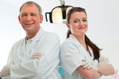 Dentists in their surgery — Stock Photo