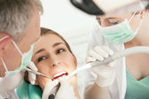 Female patient with dentist and — Stock Photo