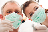 Dental treatment with dentist — Stock Photo