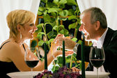 Mature couple eating romantic — Stok fotoğraf