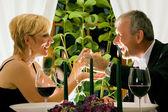 Mature couple eating romantic — Stok fotoğraf
