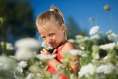 A nice young girl sniffing on — Stock Photo