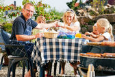 Family having a barbecue in the — Stock Photo