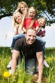 Very happy family with three — Stock Photo