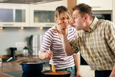 Family cooking in their kitchen — Stock Photo