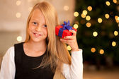 Girl in front of a Christmas tree — Stock Photo