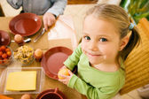 Little girl eating breakfast or — Stock Photo