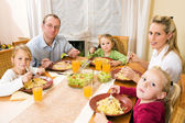 Family doing their breakfast — Stock Photo