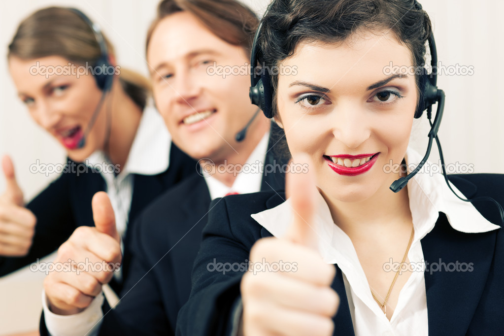 Representatives in a call center with headphones rendering service to callers  — Stock Photo #5023229