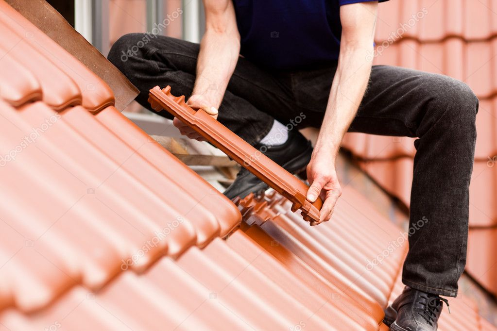 Standing on a roof covering it with tiles  — Stock Photo #5023575