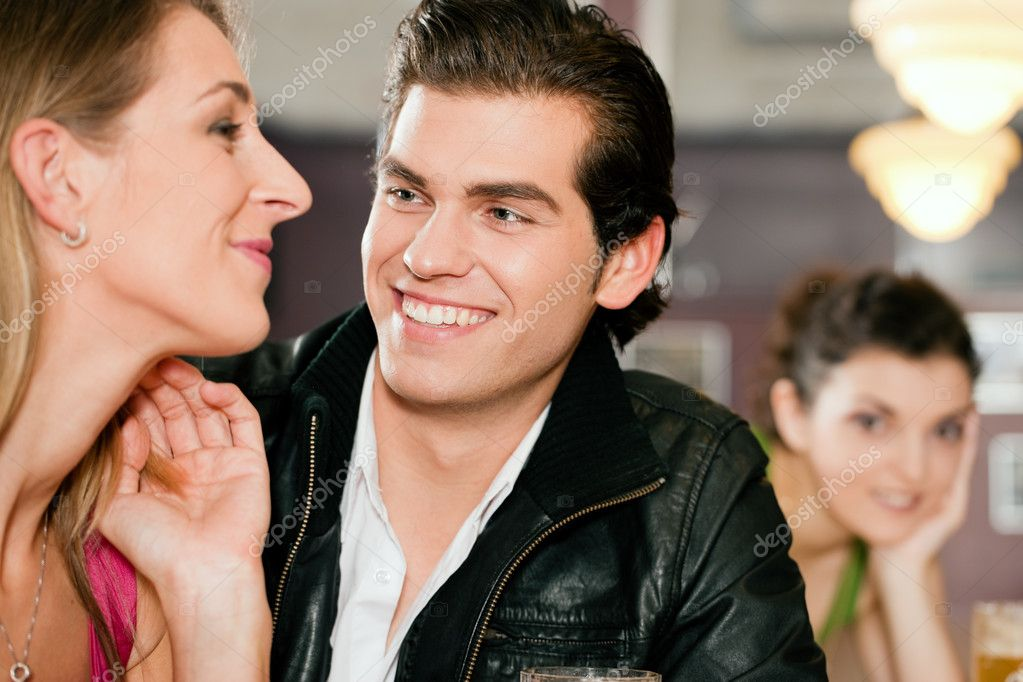 Restaurant drinking beer, one couple flirting very obviously having a lot of fun — Foto Stock #5023787