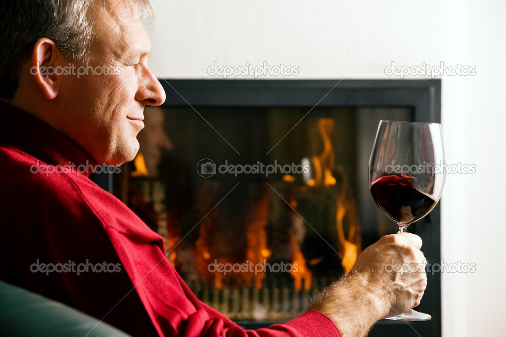 Red wine in front of a fire  — Stock Photo #5024029