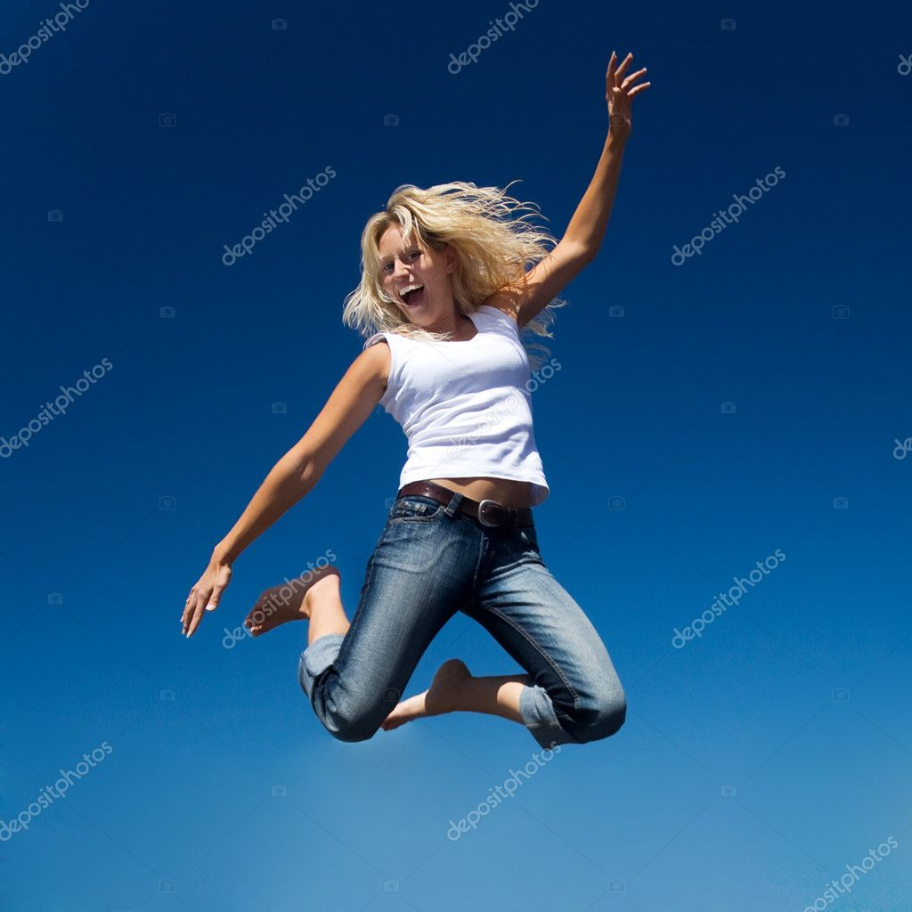 Jumping into a perfect blue sky  — Stock Photo #5024189