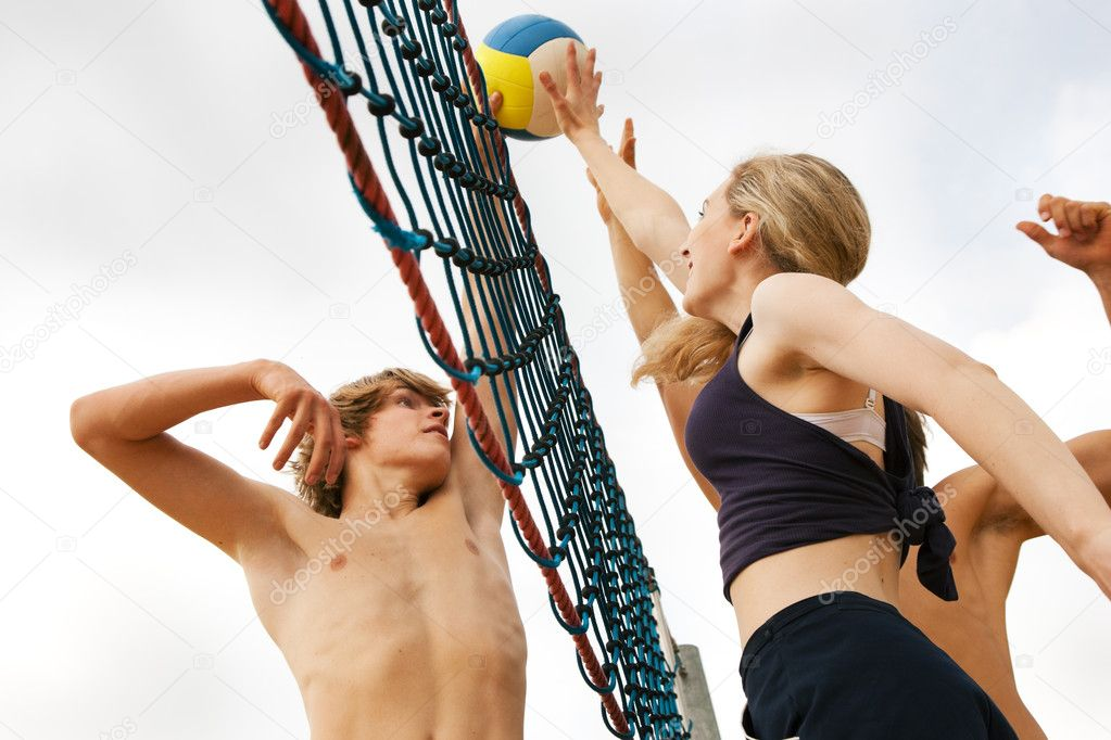 Dangerous attack in a beach volleyball game  — Stock Photo #5025091