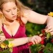 Woman doing garden work - Stock Photo