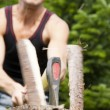 Man in his garden chopping - Stock Photo