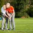Senior couple playing golf on a — Stock Photo