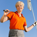 Senior woman playing golf — Stock Photo #5050611