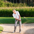 Senior golfer doing a golf — Stock Photo