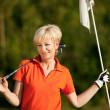 Senior woman playing golf — Stock Photo