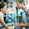 Fitness couple in the gym — Stock Photo
