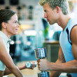 Fitness couple in the gym - Stock Photo